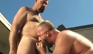 Mature gay sucks his bear boyfriend outdoor