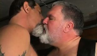 Plump mature gays kissing
