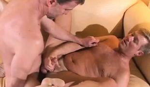 Mature gay fucks hairy man on sofa