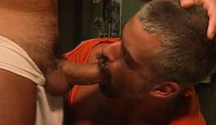 Mature prisoner sucks big cock