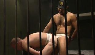 Black hairy guard drills poor prisoner