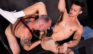 Muscled leatherman D Arclyte aggressively makes out with young stud Nate Grimes, pressing their faces tightly together and licking each other's p
