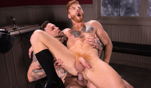 Bennett Anthony sits in the 'High n' Tight' barber's chair as Gage Unkut finishes his work