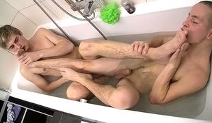 Jerry joins Timmy in the tub for a shared suck and foot wank leading to some hot loads
