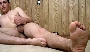 Sexy and fit young star Alexxx drains the juice out all over his naked foot