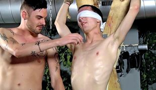 Reece pumps a load from his throbbing cock at the hands of dominant Adam