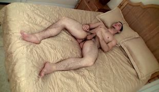 Beefy buff dude Cage shows off his naked feet and jacks his hairy dick
