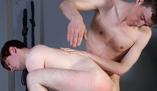 Inexperienced twink Shayne takes a spanking and a cum load from hung Sean