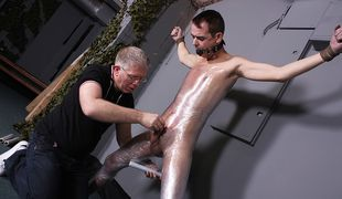 Josh gets his hard cock pleasured by the master as Sebastian sucks and wanks him
