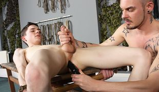 Adam stretches out the tight ass of Aaron before fucking him and making him cum!