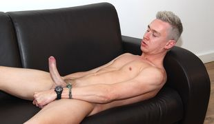 Cute new guy Jamie arrives for an interview and his very first on-screen wank