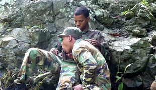 Army boys scout for hard meat outdoors